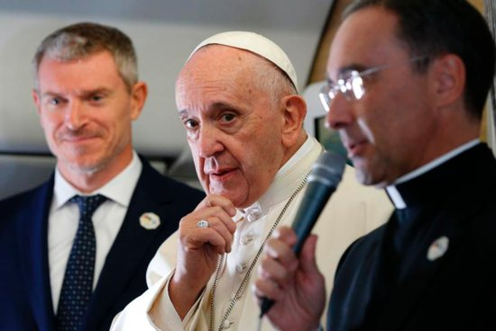 Pope Francis is pictured as he greets journalists aboard his flight from Rome to Maputo, Mozambique
