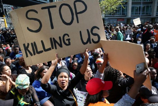 A woman holds a sign as demonstrators gather Sept. 4, 2019, at the World Economic Forum on Africa in Cape Town during a protest against gender-based violence. South African bishops called for action to end violence against women after a spate of killings and rapes sparked outrage in a country with one of the world's highest murder rates.