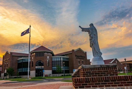 A statue of Christ is seen July 29, 2018, on the campus of Newman University in Wichita, Kan.