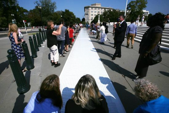 Pro-life leaders unfurl a petition with more than 250,000 signatures