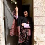Surgical masks, social distancing: Palm Sunday in Jerusalem's Old City