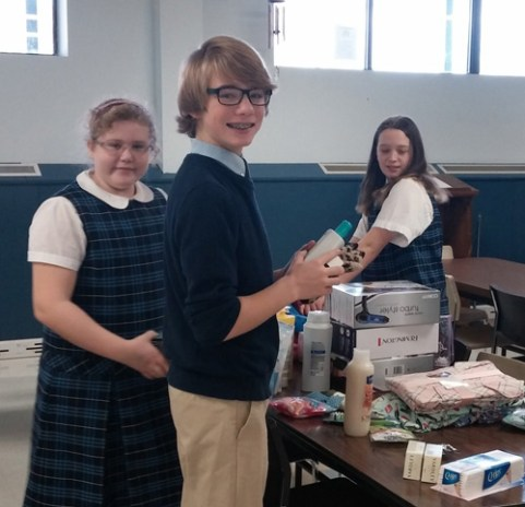At St. Mary's Academy in Baldwinsville, students worked together to assemble baskets of donations for Joseph's House for Women, a home for mothers in need and their children.