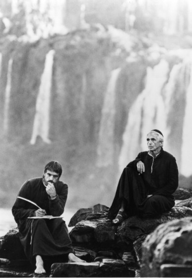 "Jeremy Irons and Jesuit Father Daniel Berrigan (right) appear in a scene from the 1986 movie ""The Mission."" (CNS photo 