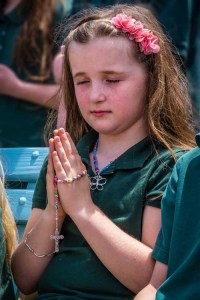 Second grader Breanne Eldred, 8,  from All Saints Schoo pray at the Marian Shrine at St. Joseph Church in Endicott Thursday reciting the rosary. -Sun photos | Chuck Haupt