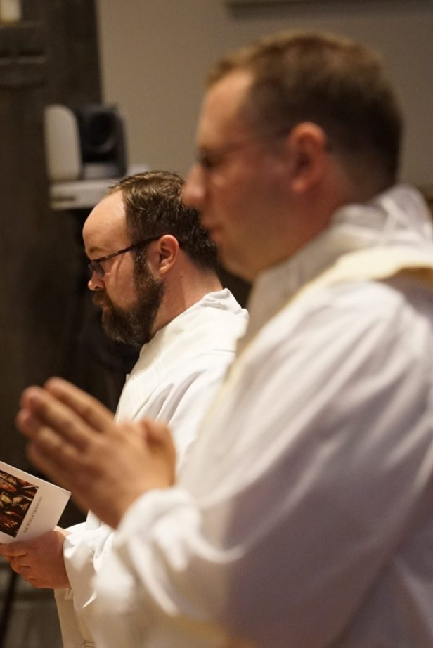 Father Kenneth Kirkman prays during his ordination Mass. (Sun photo | Chuck Wainwright)