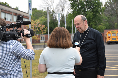 And Bishop Cunningham offered an interview as well. (Sun photo | Katherine Long)