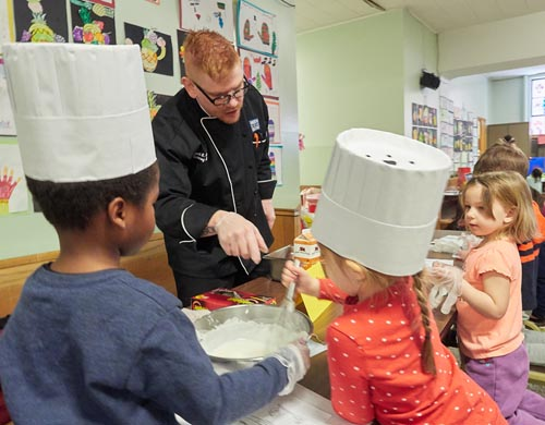 Chef Scott Ferguson supervises an activity on Career Day for three- and four-year-olds Feb. 2 at Blessed Sacrament School in Syracuse. - Sun PHOTO | CHUCK WAINWRIGHT