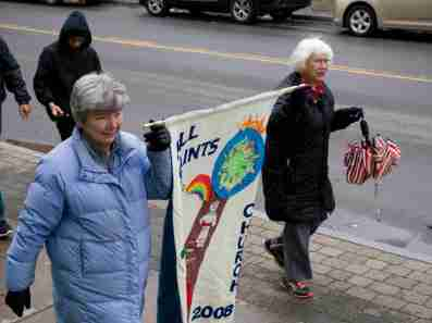 People participate in a May 7 procession in solidarity with refugees, sponsored by Catholic Charities of Onondaga County and InterFaith Works. (Sun photo | Chuck Wainwright)