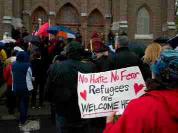 People participate in a May 7, 2017, procession in solidarity with refugees, sponsored by Catholic Charities of Onondaga County and InterFaith Works. (Sun photo | Chuck Wainwright)