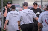 All celebrate the Men In Black softball game in Endicott on Sunday. The priests and seminarians won, 15 to 8, against the parishoners of OLGC and St. Ambrose. Pictured is Seminarian Nathan Brooks, left and Fr. Michael Guluppi.