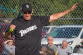 Fr. Michael Galuppi waves to crowds as he come up to bat during the Men In Black Softball game in Endicott on Sunday.