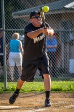 Fr. Michael Galuppi make contact while at bat during the Men In Black Softball game in Endicott on Sunday.