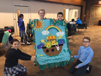 Pictured with their finished fleece blanket, from left, are fifth-grader Sophie Oliva, sixth-grader Peyton Woodcock, and fifth-graders Max Costello and Max Hann.