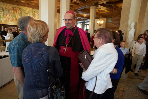 Bishop Cunningham greets well-wishers at the reception following the liturgy. (Sun photo | Chuck Wainwright)