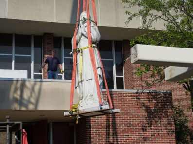 statue in straps being removed - Icons take trip but still tower over Valley