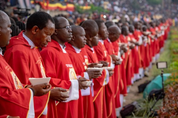 Hundreds of Ugandan priests line up, preparing to distribute Communion to the nearly one million people who attended the Martyrs Day Mass.