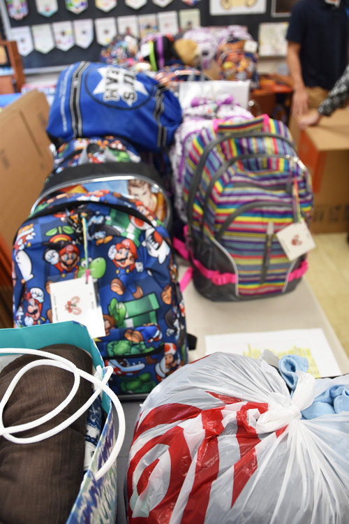 vertical of backpacks - Two countries rejoice  as one at Christmastime
