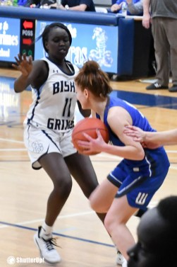 Grimes girl No. 11 defends - For high school hoop teams, it's a feverish February