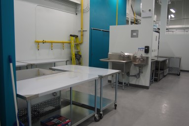 Prep kitchen with stainless steel tables and sinks