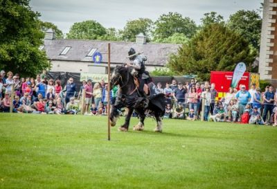 Flavours of Fingal Country Show Dublin Ireland - The Cavalry of Heroes Medieval Jousting Stunt Show - Dark Knight Target Practice Trick behind the head