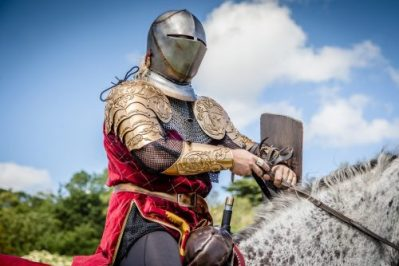 Flavours of Fingal Country Show Dublin Ireland - The Cavalry of Heroes Medieval Jousting Stunt Show - Golden Knight helm on preparing to joust