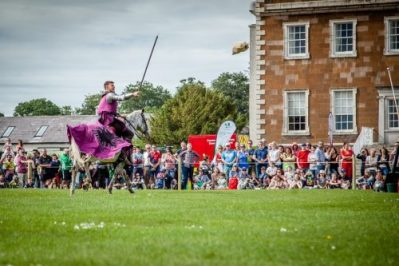Flavours of Fingal Country Show Dublin Ireland - The Cavalry of Heroes Medieval Jousting Horse Stunt Show - Knight Sir Robert celebrating successful target practice