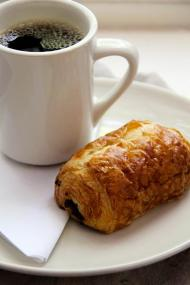 A nice cup of hot La Colombe coffee and a chocolate croissant