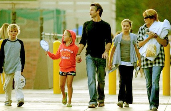 Mr. & Mrs. Olyphant with their three kids