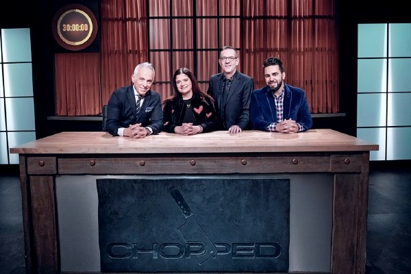Chef Geoffrey Zakarian with his cast member of Chopped