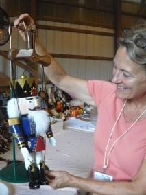 Karen Jeffrey with marionette at rummage sale