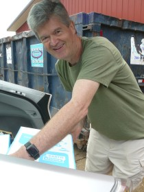 Mark Walker unloading a car of rummage