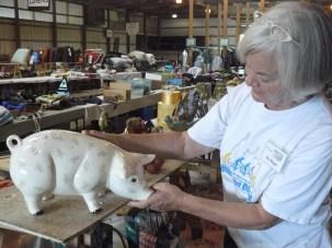 Pat Burger and pig at rummage sale
