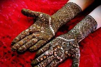 Putting Mehndi on their hands is one part of the make-up and getting all ready for the evening pooja