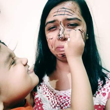 Real Mom  Manali Tiwari - son scribbling on her face