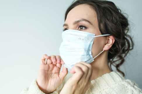 Woman wearing a mask - Coronavirus Health Insurance