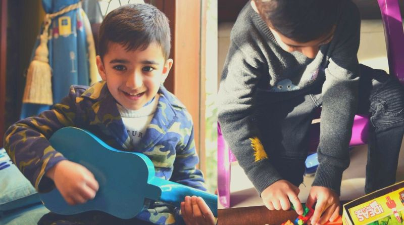 Thought Of The Day For Kids - Boy with guitar and cleaning his toys