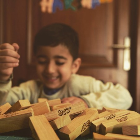 A boy with soft skills playing Jenga