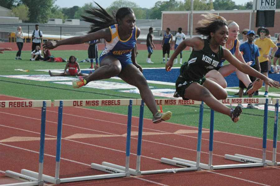 Rajah+Ramsey+and+Emily+Hankins+run+the+100+meter+hurdles.+Ramsey+came+in+2nd+place+with+Hayward+following+with+3rd.