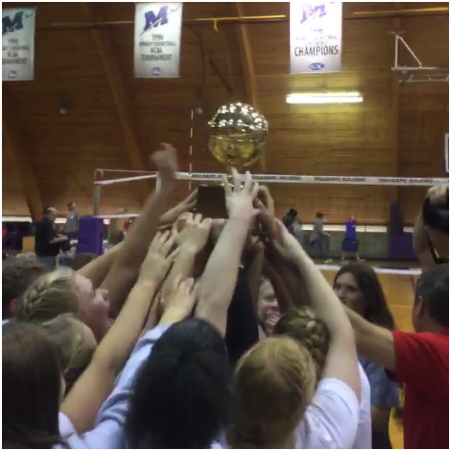 The OHS Volleyball team hoists the golden ball after winning the MHSAA Class II State Championship.