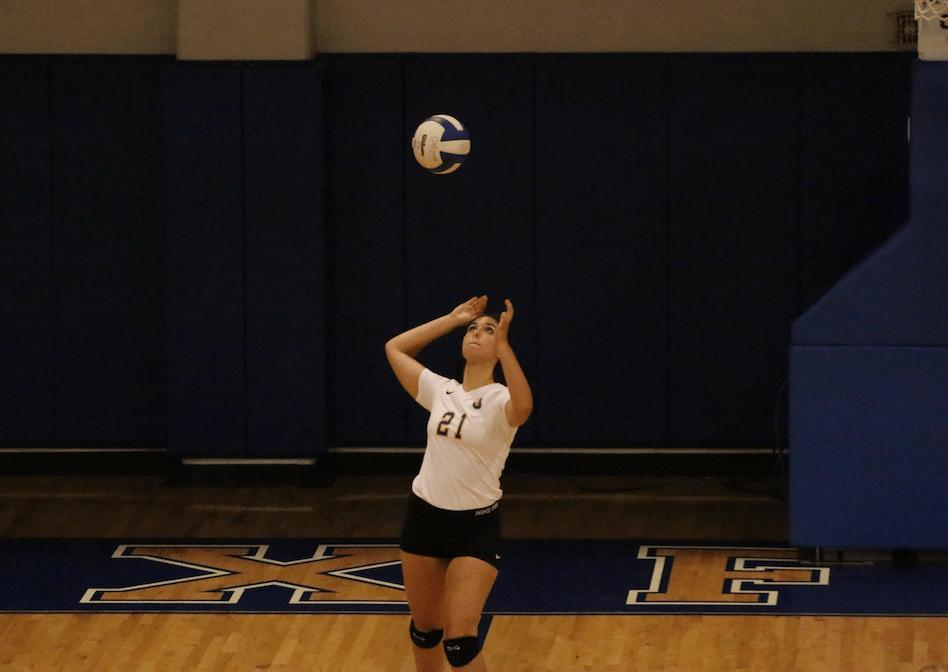 Senior Haley Caradine serves the ball against Corinth.