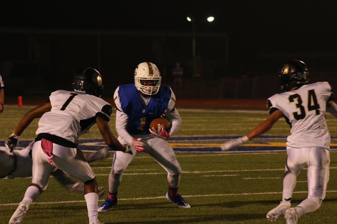 Hiram Wadlington runs the ball against the Trojan defense. The Chargers went on to beat the Trojans 31-13 in Friday night's Homecoming game.