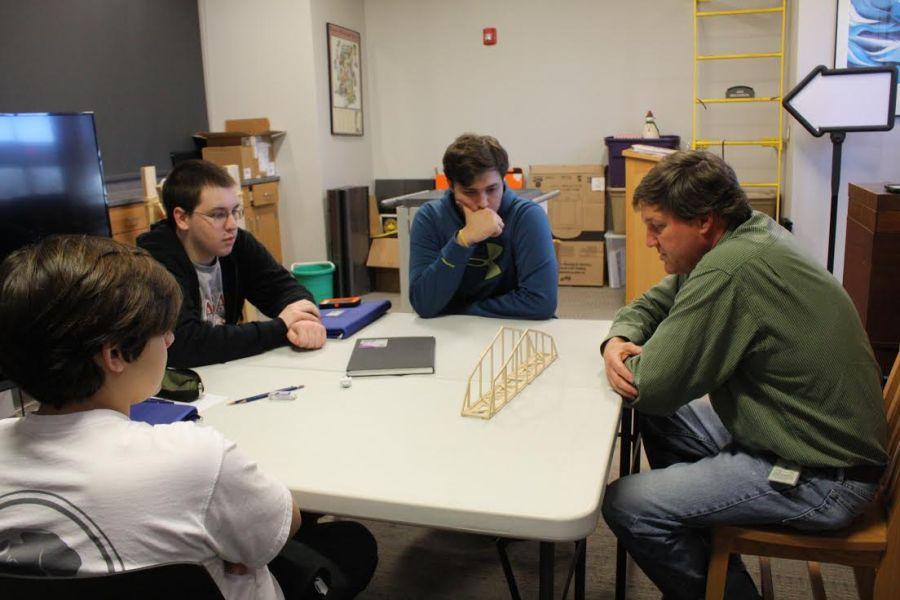 Civil+Engineer+for+MDOT+David+Evans+III+helps+members+of+the+engineering+club+with+their+bridge.
