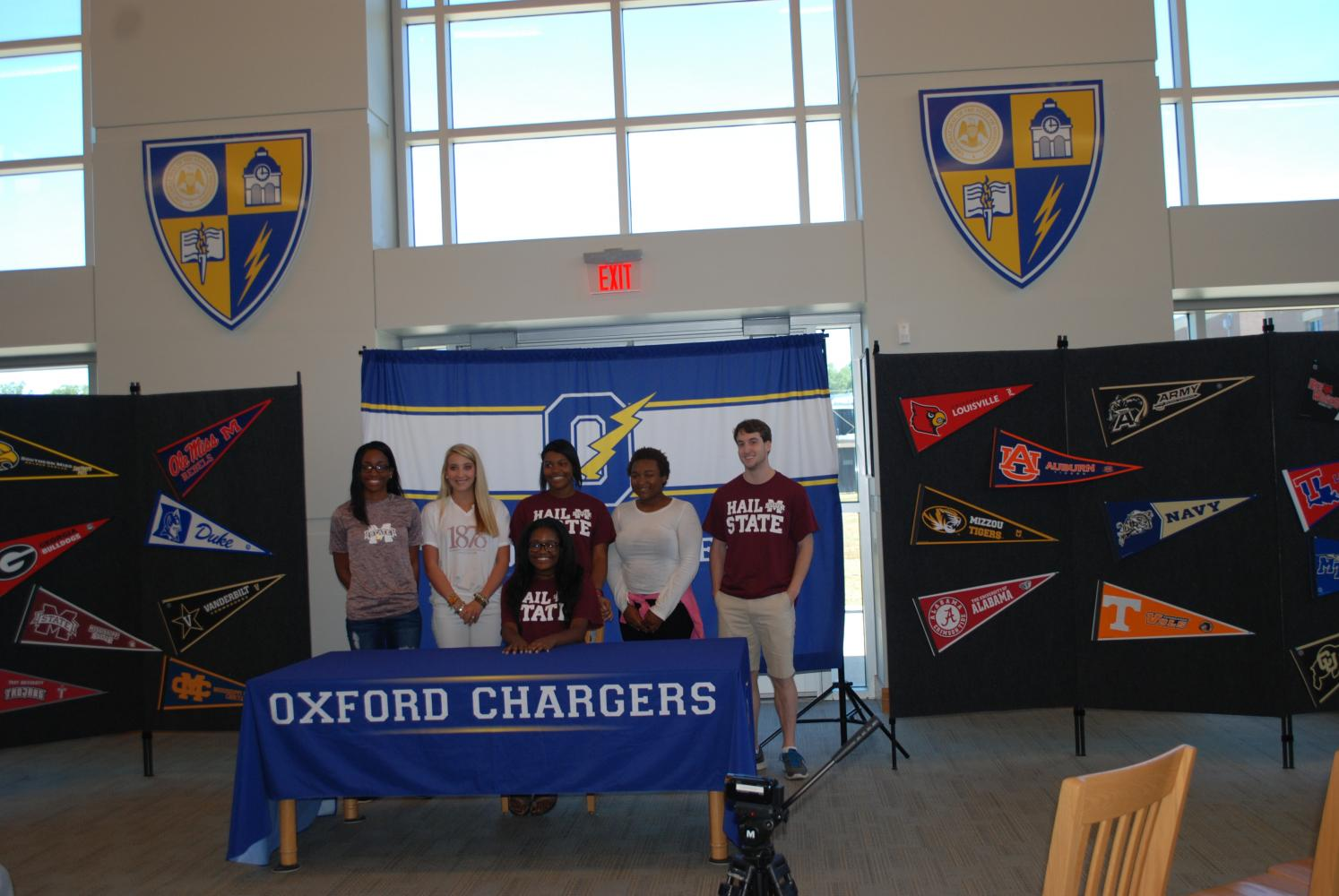 Seniors gather for a photograph after senior signing day in the library.