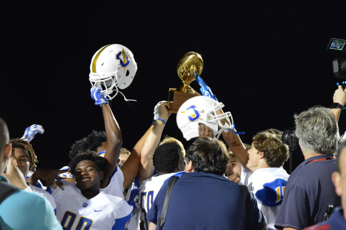 The+Chargers+hoist+the+Crosstown+Classic+Trophy+following+the+Oxford%27s+41-17+win+over+Lafayette.