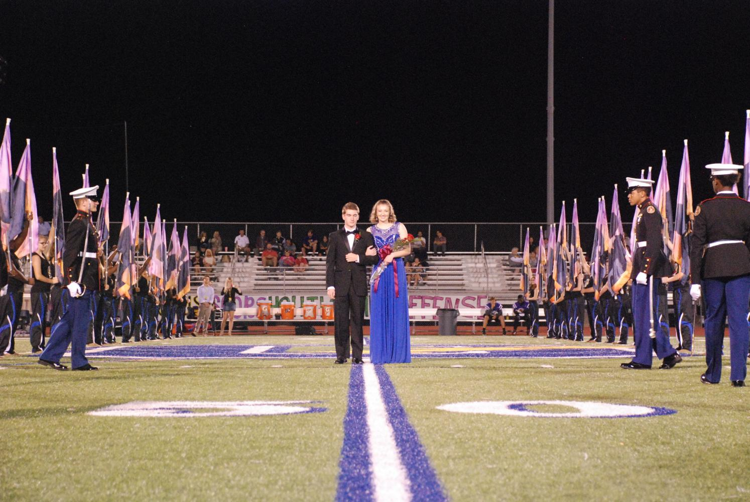 Lily Mitchell stands with escort Cole Moore having just been announced Homecoming Queen. Mitchell was crowned Thursday, Oct. 5, at the homecoming game against Desoto Central.
