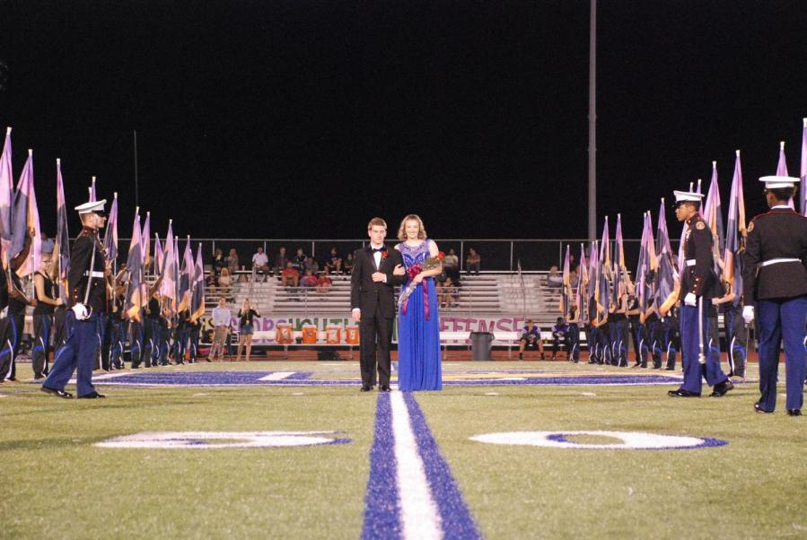 Lily+Mitchell+stands+with+escort+Cole+Moore+having+just+been+announced+Homecoming+Queen.+Mitchell+was+crowned+Thursday%2C+Oct.+5%2C+at+the+homecoming+game+against+Desoto+Central.