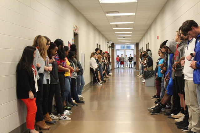 Students+stand+in+the+hallway+of+Oxford+High+School+and+participate+in+a+moment+of+silence+to+commemorate+the+lives+of+the+victims+of+the+school+shooting+in+Parkland%2C+Florida.+The+names+of+the+17+victims+were+read+during+this+time.+