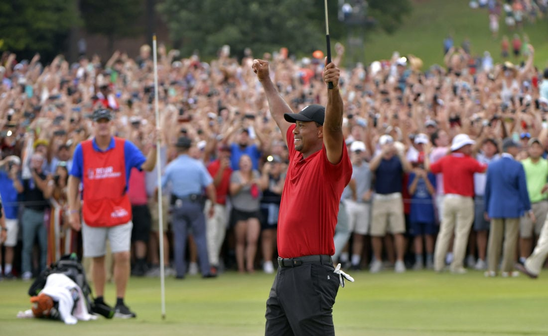 Tiger Woods raises his hands in triumph after shooting his final hole. This weekend, Woods won the PGA Tour Championship for the first time since 2013.