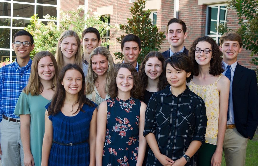 Marawan Elghory, Maggie Livingston, Brannan Kovachev, Jack Ligon, Preston Hooker, Claire Pearson, Meredith Goza, Eve Gershon, Gillian Meyers, Siena Cizdziel, Sydney Rester and Anneke Buskes stand and smile. All 13 students were named National Merit Finalists.