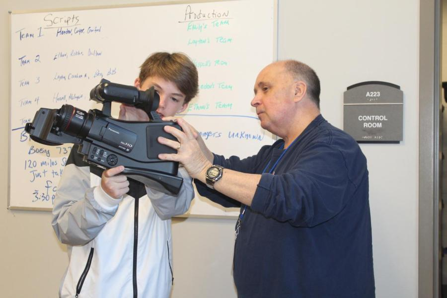 Broadcast+Journalism+teacher+Keith+Scruggs+helps+freshman+Joel+David+Montgomery+with+one+of+the+broadcast+cameras.+Scruggs+has+taught+for+six+years%2C+but+this+is+his+first+year+teaching+at+OHS.